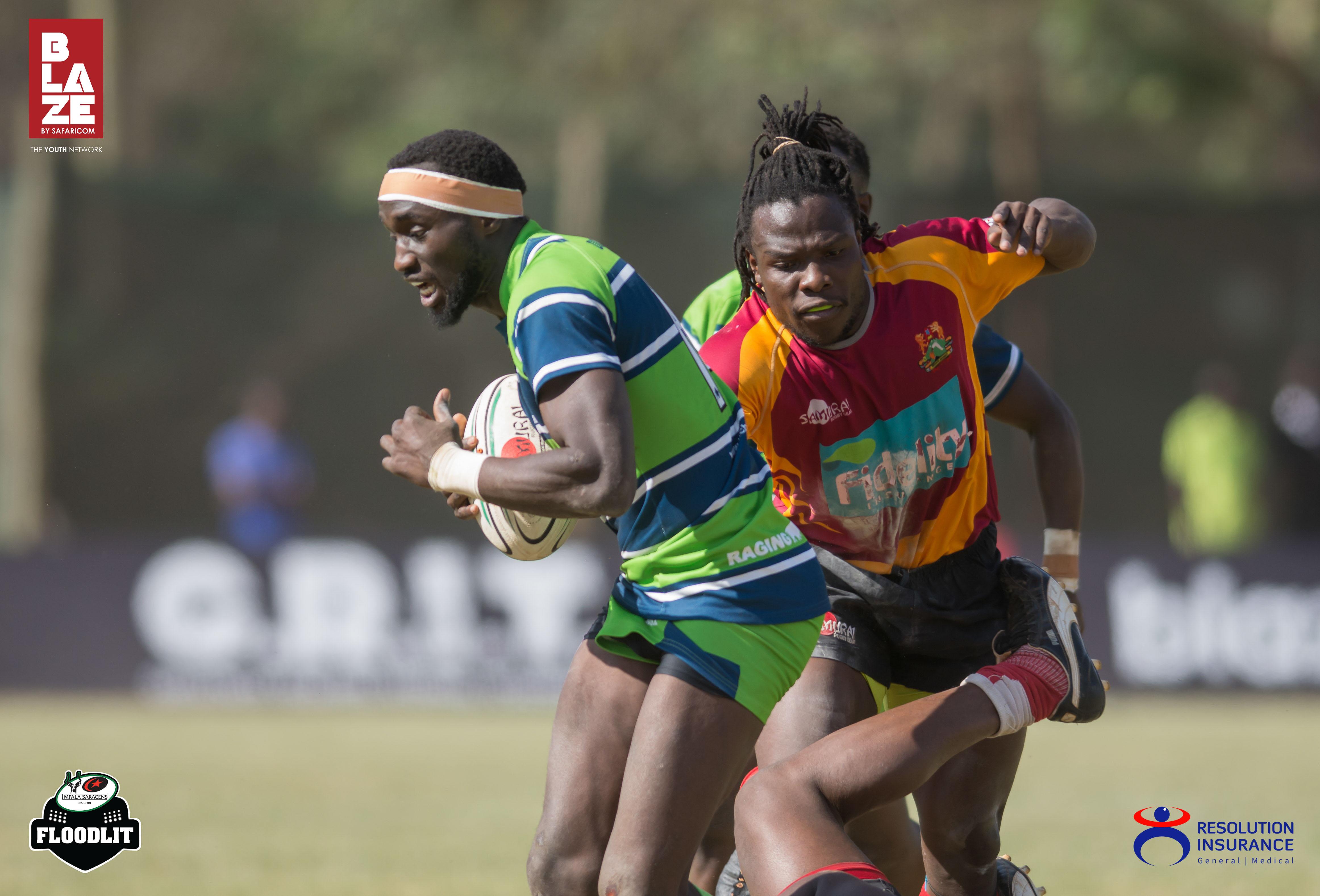 Tony onyango of KCB brushing off a tackle from Archadius Khwesa of Blakblad.